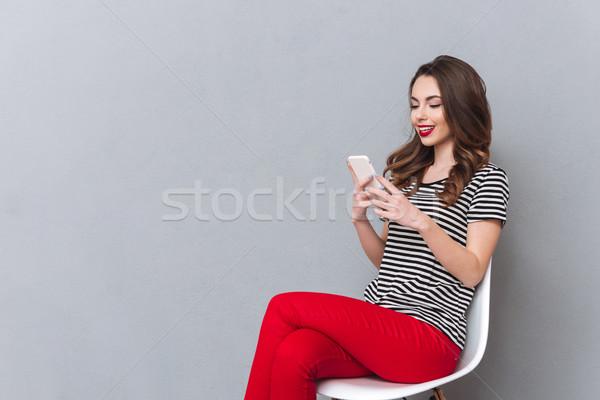 счастливым молодые Lady серый стены Сток-фото © deandrobot