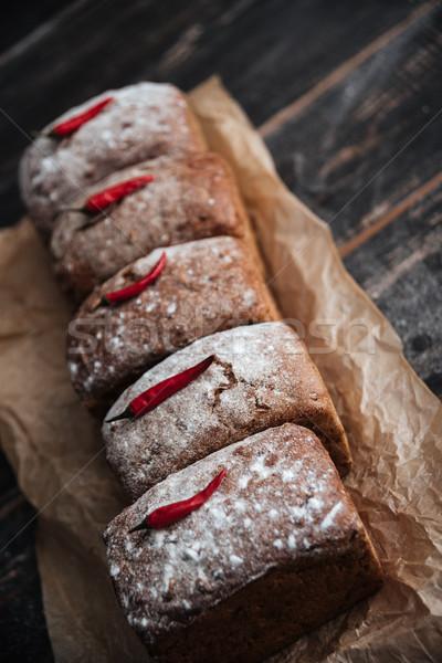 Chleba mąka pieprz Fotografia ciemne drewniany stół Zdjęcia stock © deandrobot
