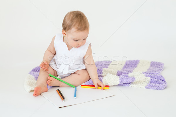 Little baby girl sitting on floor with plaid and markers Stock photo © deandrobot