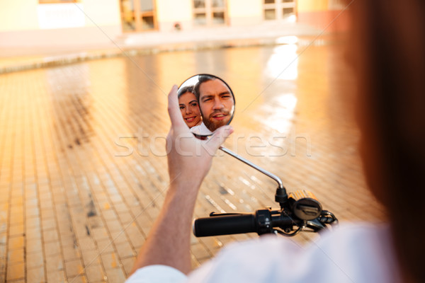 Image of business couple rides on modern motorbike outdoors Stock photo © deandrobot
