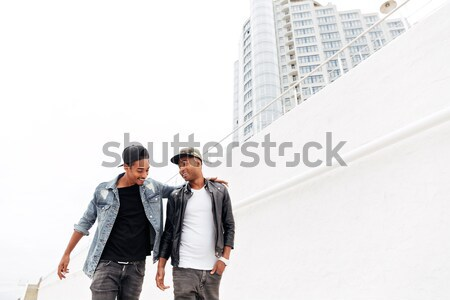 Handsome two young african men friends walking Stock photo © deandrobot
