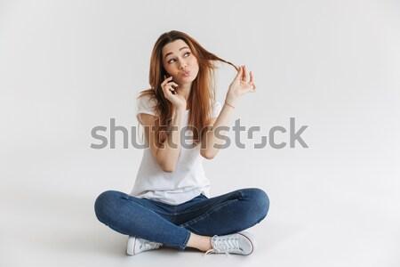 фото красивой брюнетка женщину длинные волосы прикасаться Сток-фото © deandrobot
