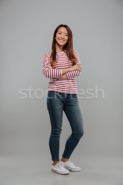 Retrato feliz asiático menina em pé brasão Foto stock © deandrobot
