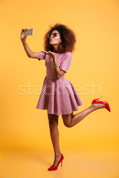 Full length portrait of a lovely afro american woman Stock photo © deandrobot