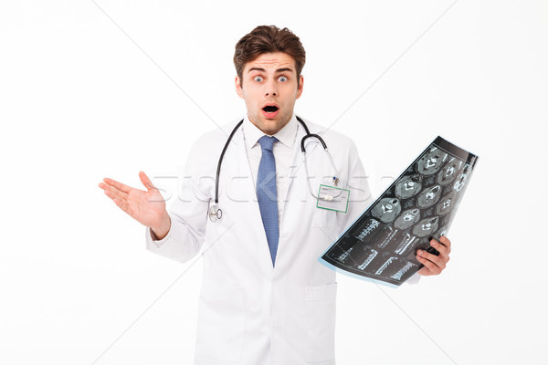 Portrait of a confused frustrated young male doctor Stock photo © deandrobot