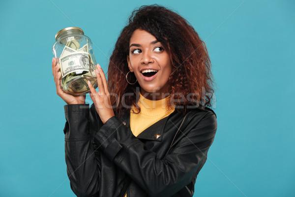Feliz africano mulher jaqueta de couro jarra Foto stock © deandrobot