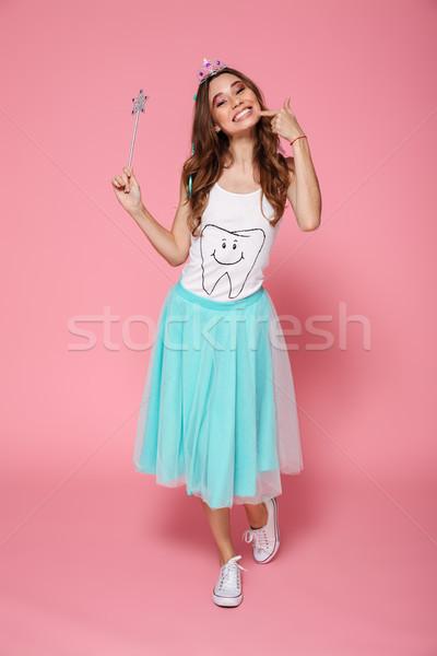Full-length photo of overjoyed birthday girl in diadem holding m Stock photo © deandrobot