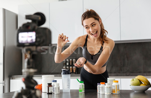 Excited healthy young girl recording her video blog Stock photo © deandrobot