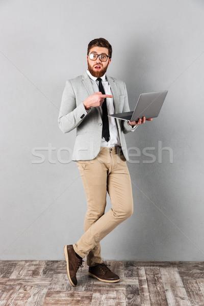 Ritratto confusi imprenditore suit Foto d'archivio © deandrobot