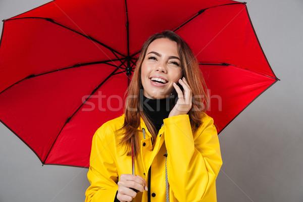 Portré boldog lány esőkabát áll nyitva esernyő Stock fotó © deandrobot
