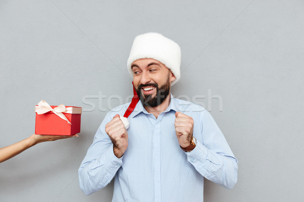Happy Bearded man in business clothes and christmas hat Stock photo © deandrobot