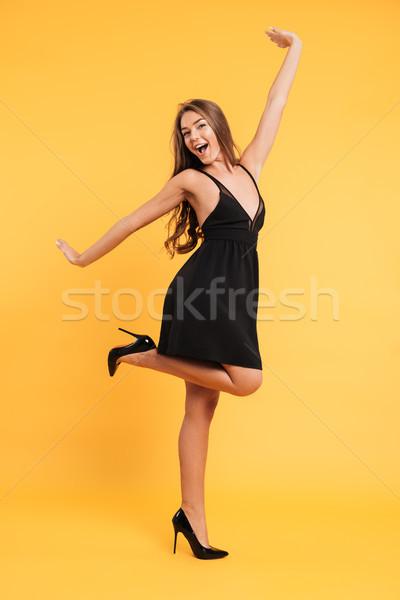Heyecanlı mutlu genç bayan siyah elbise fotoğraf Stok fotoğraf © deandrobot