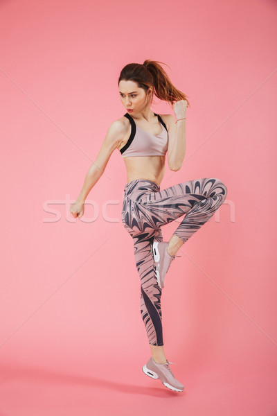 Full length image of Concentrated sportswoman doing fitness exercise Stock photo © deandrobot