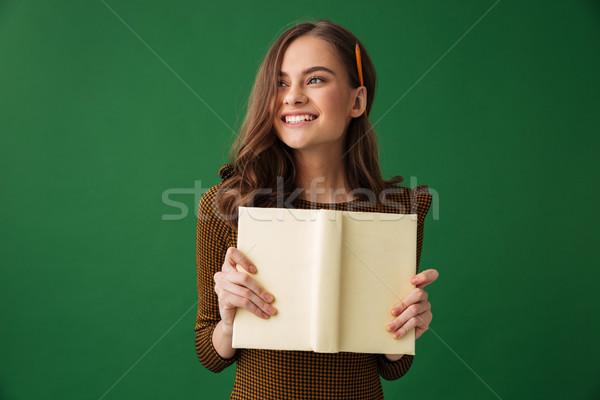 Elképesztő fiatal nő olvas könyv kép áll Stock fotó © deandrobot