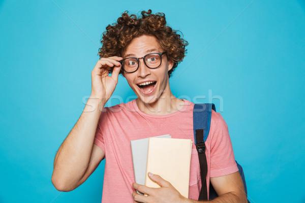 Foto glücklich College Mann lockiges Haar tragen Stock foto © deandrobot