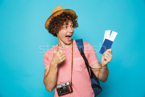 Photo of happy camera man 18-20 with curly hair wearing backpack Stock photo © deandrobot