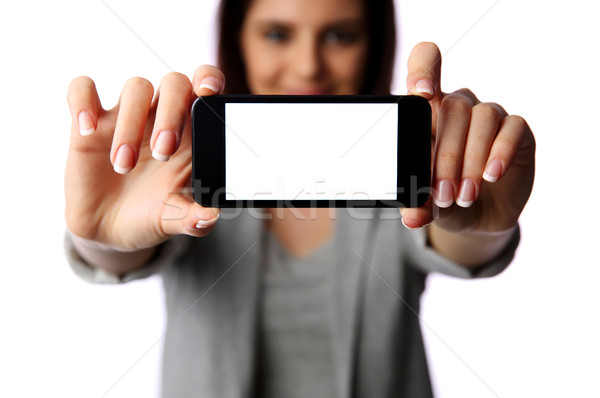 Woman showing smartphone screen isolated on white background Stock photo © deandrobot