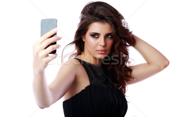 Beautiful woman taking self picture with smartphone camera Stock photo © deandrobot