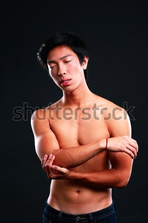 Man checking his pulse by pressing the wrist with fingers Stock photo © deandrobot