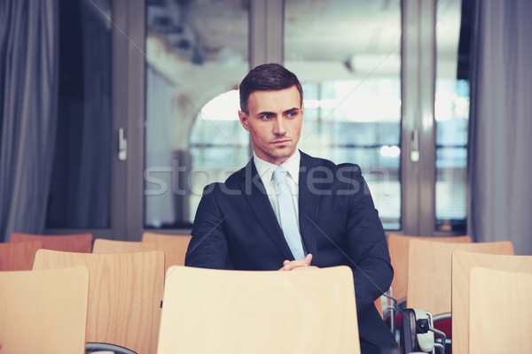 Pensive businessman sitting at conference hall Stock photo © deandrobot