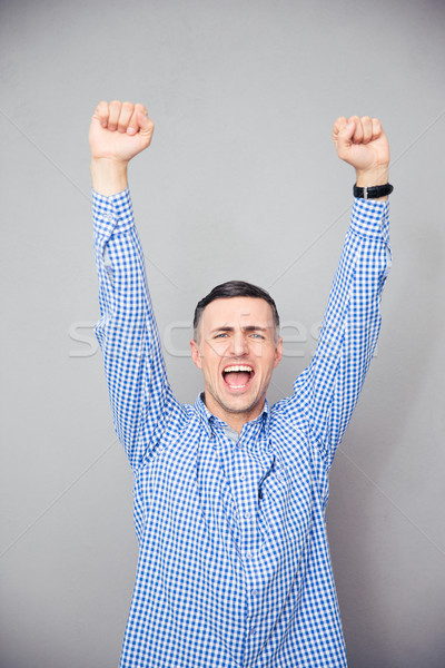 Man raised hands up. Making victory gesture Stock photo © deandrobot