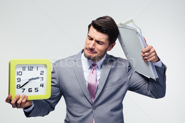 Decepcionado empresario carpetas reloj gris Foto stock © deandrobot