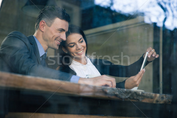 Stock photo: Businesswoman and businessman using smartphone in cafe