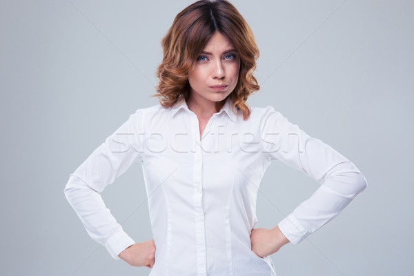 Portrait of a cute offended woman Stock photo © deandrobot