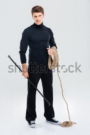 Spor adam ayakta silah katlanmış tam uzunlukta Stok fotoğraf © deandrobot
