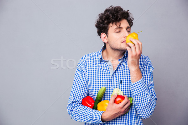 Man holding smelling vegetables Stock photo © deandrobot