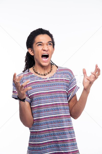 Angry afro american man shouting Stock photo © deandrobot