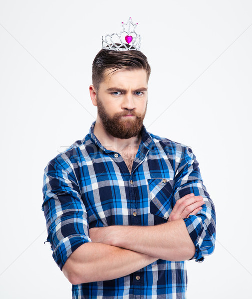 Man in queen crown standing with arms folded  Stock photo © deandrobot