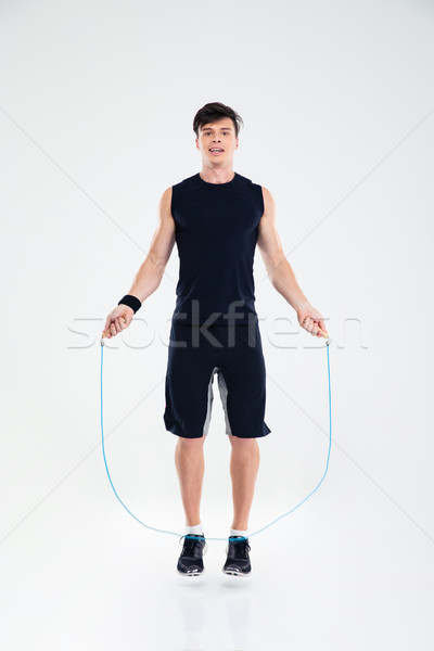 Man jumping with skipping rope Stock photo © deandrobot