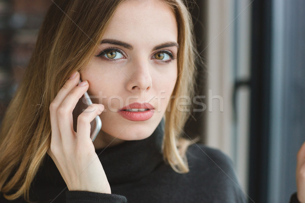 Closeup of beautiful woman talking on cell phone Stock photo © deandrobot