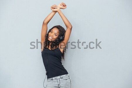 Back view of sensual attactive young woman with raised hands  Stock photo © deandrobot