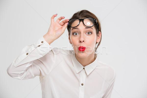Maravilhado empresária olhando câmera isolado branco Foto stock © deandrobot