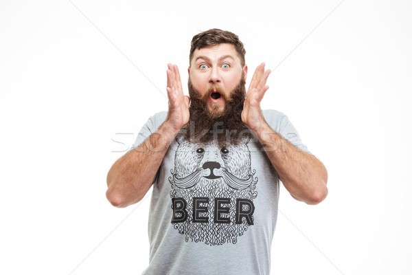 Surprised handsome bearded man with opened mouth Stock photo © deandrobot