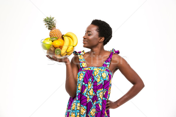 Uśmiechnięty piękna Afryki kobieta stałego stwarzające Zdjęcia stock © deandrobot