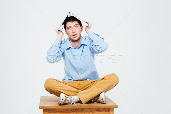 Zmęczony człowiek laptop głowie posiedzenia tabeli Zdjęcia stock © deandrobot