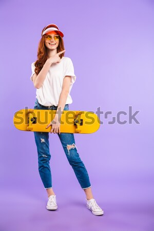 Smiling woman holding retro boom box  Stock photo © deandrobot