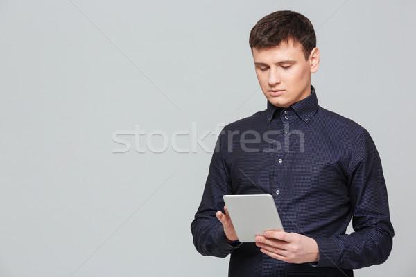 Businessman using tablet computer Stock photo © deandrobot