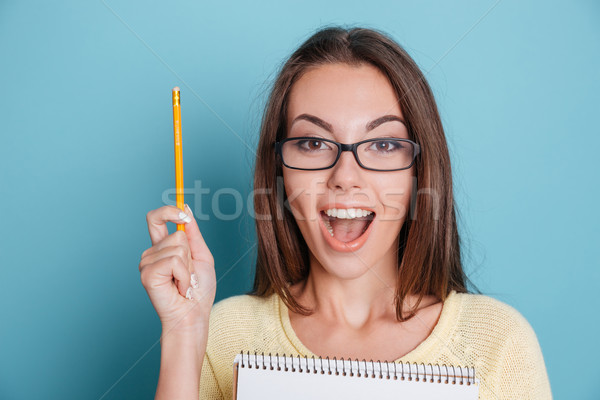 Close-up portrait of a beautiful excited woman in eyeglasses Stock photo © deandrobot