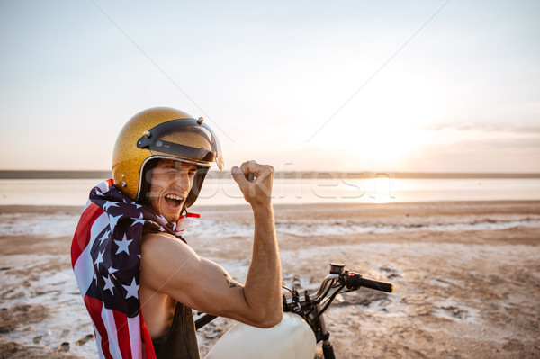 Man in american flag cape showing biceps Stock photo © deandrobot
