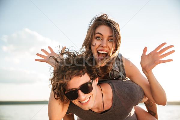 小さな 幸せ 笑みを浮かべて カップル 愛 ピギーバック ストックフォト © deandrobot