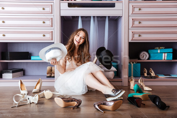 Stock photo: Beautiful young woman sitting in her closet