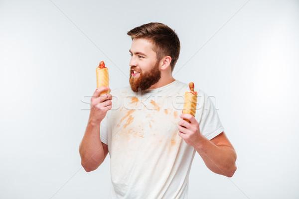 Boldog szakállas férfi mocskos póló tart Stock fotó © deandrobot