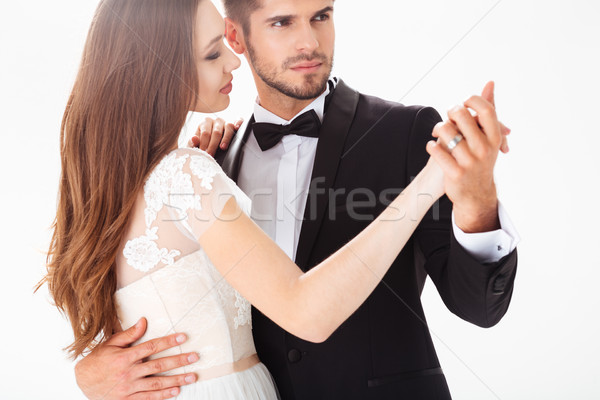 Dancing newlyweds in studio Stock photo © deandrobot