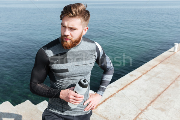 Stock photo: Male runner with water
