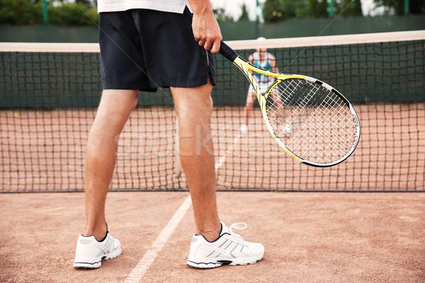 Legs of tennis man Stock photo © deandrobot