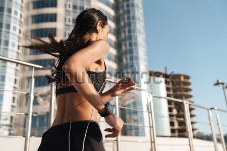 Beautiful young woman in swimwear standing outdoors at sunrise Stock photo © deandrobot